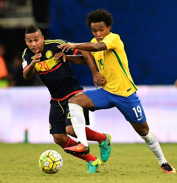Brazil's Willian (R) and Colombia's midfielder Macnelly Torres vie for the ball…