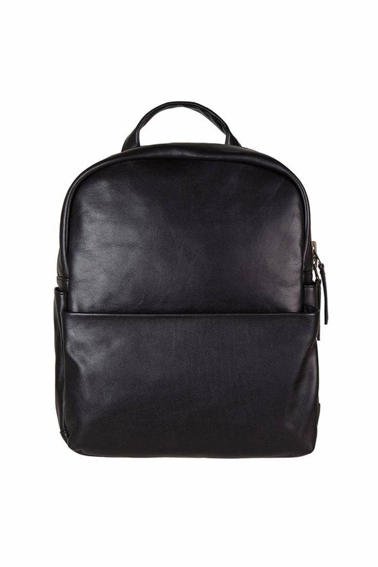 "This black leather backpack is perfect for your daily travels in comfort, practicality and of course super-awesome appearance.   It's the bag to journey well with you through all of life's wanderings. Adjustable shoulder straps, Outside zipper and side, iPhone stash pockets, Inside zipper and 13"" laptop sleeve. 35cm x 30xm x 11cm Leather Backpack by Status Anxiety. Bags - Backpacks Canada"