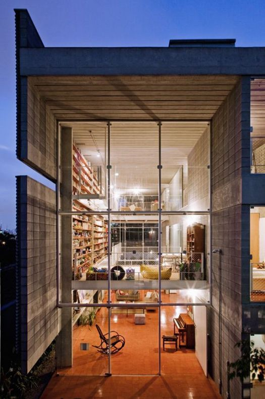 Brazilian home with an incredible library design
