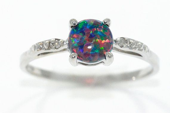 Hey, I found this really awesome Etsy listing at https://www.etsy.com/uk/listing/165393362/black-opal-diamond-round-ring-925