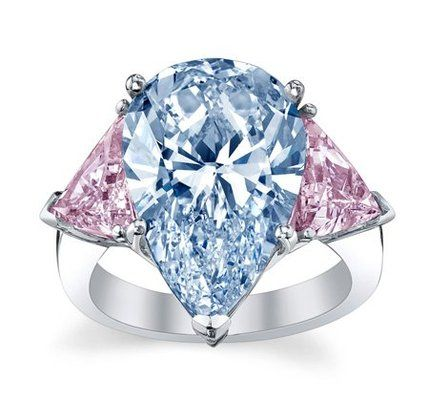 Magnificent Pear Shape Blue diamond weighing 7 carats with pink diamonds mounted in platinum