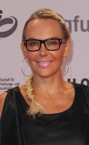 Looking for back frame eyeglass inspiration? Look no further. Check out this gallery of celebrities rockin' black frame glasses.: Natascha Ochsenknecht