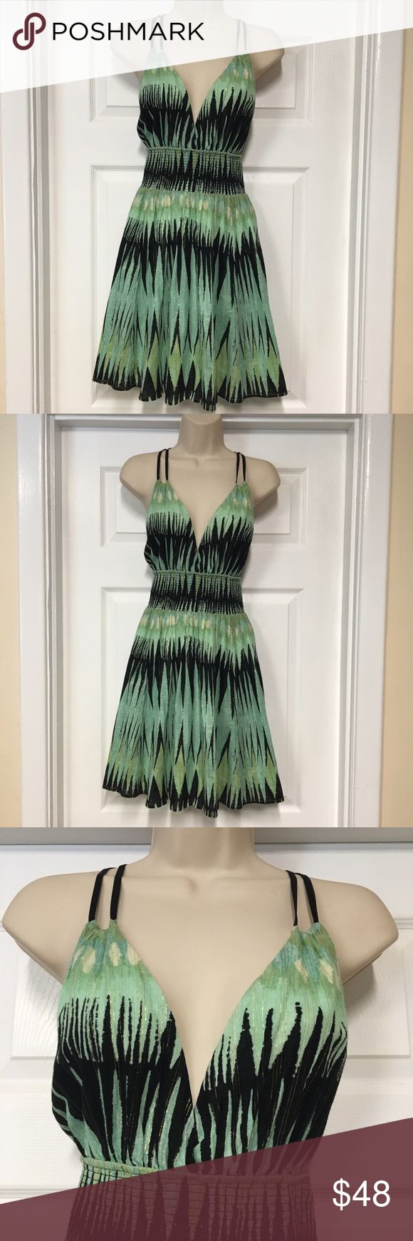 Free people mint green & black sundress medium Very pretty sundress from free people. Size medium. Beautiful shade of mint green mixed with black and tiny gold threads woven through it. Elastic waist. Free People Dresses