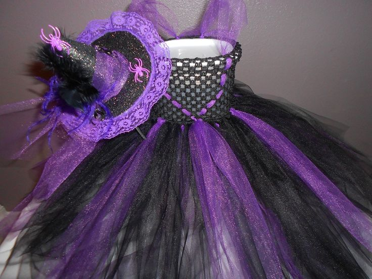 """HAPPY SPOOKY  HALLOWEEN! This """"friendly witch"""" tutu costume will look adorable on your little one while she trick-or-treats. It was made with 2 layers of Purple and Black tulle with 6in. black crochet top. Measures approx. 23in. long will fit 2T-4T. Comes with a black covered headband with attached glitter witch hat purple tulle feathers and spiders. 2T-4T  To make this little witch complete will be some face make-up. $50.00 with free shipping"""