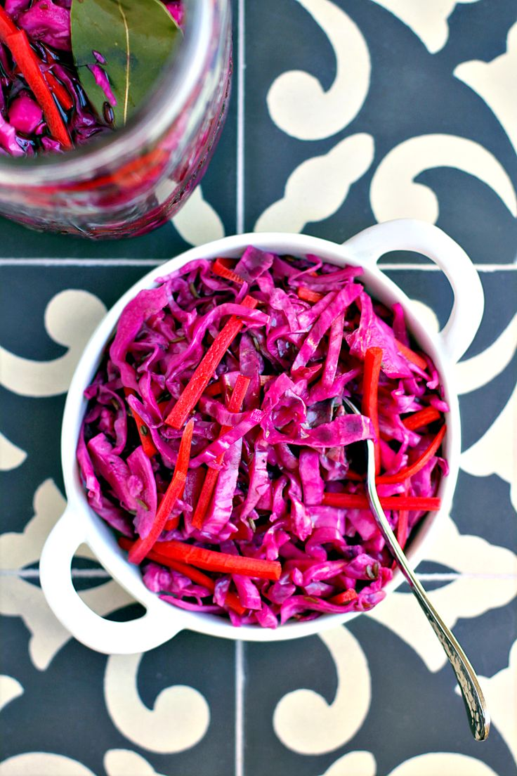 To make this quick pickled red cabbage and carrots condiment, simply combine the ingredients in a jar and let them sit. That's it.