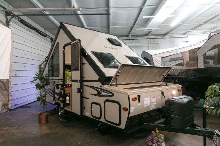 """A BETTER KIND OF POP-UP!  2017 Forest River Rockwood Hard Side A122S If lightweight and easy to tow is what you're after the Rockwood Hard Side A122S is the way to go! This RV has all the benefits of a pop-up but with no tent material to leak water or heat! At only 2,133 lbs dry and 5' in height when it's closed, this 18' 11"""" long RV tows like a dream! Give our Rockwood Hard Side expert Zachary VanEss a call 616-401-3491 for pricing and more information."""