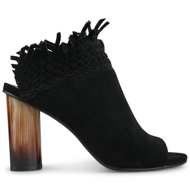 Crafted from plush black suede, these stunning statment mules combine contemporary crafting techniques with a classic slip on upper. With a versatile fringe detail that can be worn folded up or down, and a hand painted 10cm* block heel, Row are a careful
