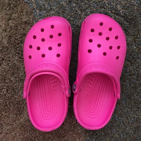 Hot pink crocs Gently used hot pink crocs. I wore them a couple times but they are too small for me. Great condition, only a couple barely noticeable marks crocs Shoes
