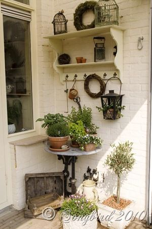 Love this Vignette-with the white black and rustic brown then accents of green.