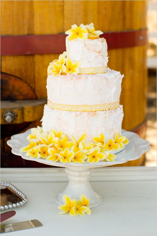 Tropical and rustic styling combined!!! white wedding cake with plumeria