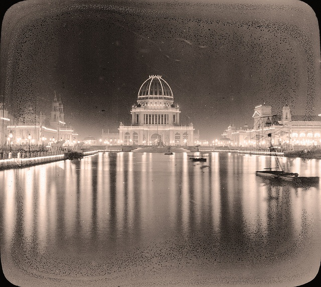 In 'House of Shadows', short Gothic romance from Providence Lyceum, the engaged loving couple is to honeymoon at The White City; here it is at night, 1893 World's Colombian Exposition.