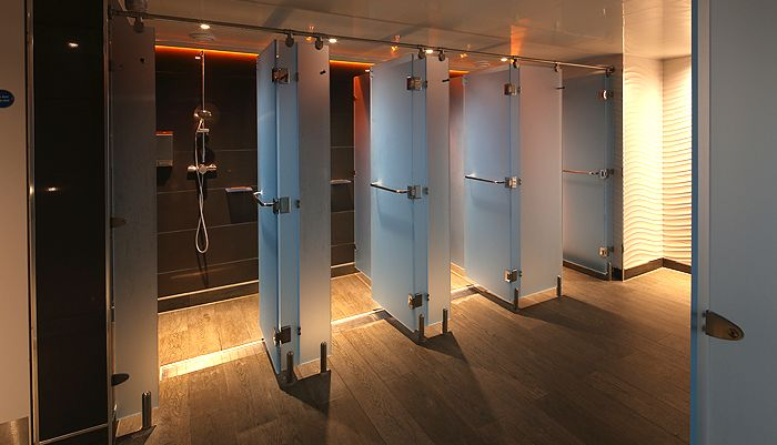 A fitness club in the UK where Perspex® (known as Lucite Lux® in North America) Frost was selected over glass for a warm, private shower environment.