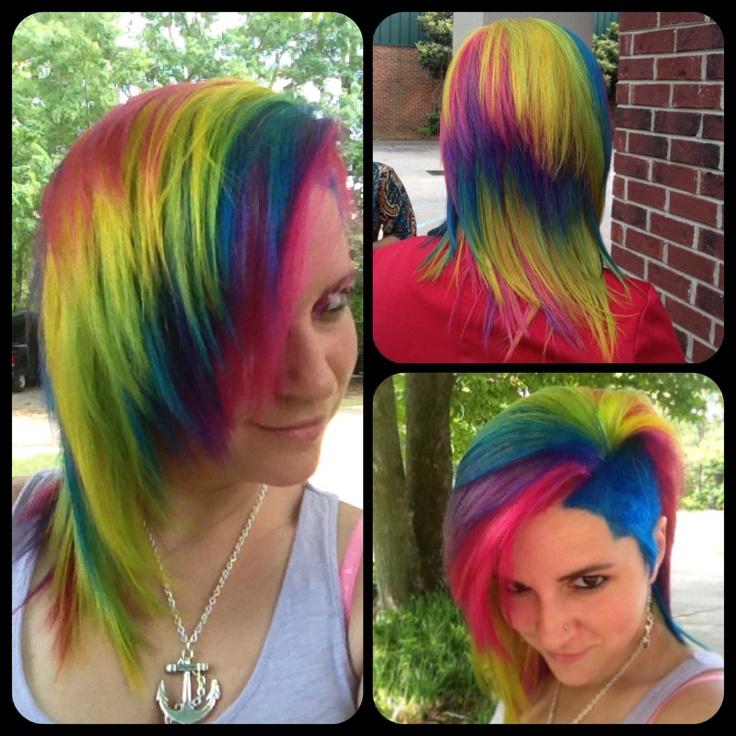 Rainbow hair, hot pink, purple, blue, green, yellow, long layered, asymmetrica,l undercut, shaved hair cut style. Paul Mitchell Ink Works