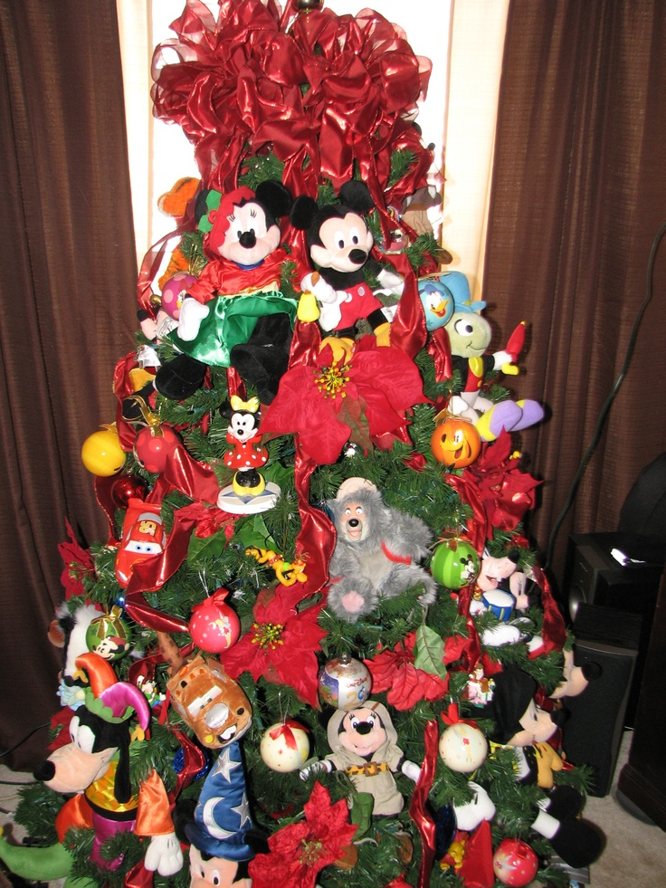 Disney Christmas Tree Put Together With Stuffed Disney Toys Found At A Thrift Store Disney Christmas Tree Christmas Tree Design Holiday Christmas Tree