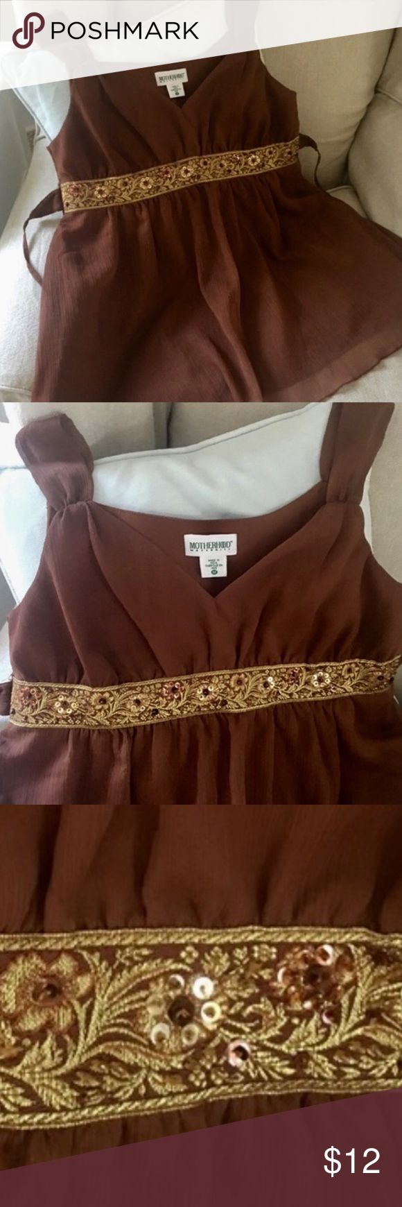 Motherhood boho cool embroidered bling top Get stylin' momma bear, you deserve to look sexy in this Motherhood Boho beauty! Gorgeous chocolate color is enhanced by golden shimmery embroidery at the gathered top. You will feel comfy and cool while looking fabulous! In excellent condition ❤️   Please browse my closet; Anthropologie, Hollister, Aerie, American Eagle, Victoria's Secret, Free People, J Crew, LF, Eddie Bauer, Boston Proper, Express, Boho styles, boutique, Nike, Strasburg…
