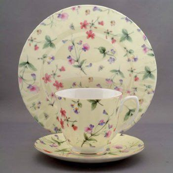 """Sweet Pea on Yellow Bone China TeaCup & Saucer. 8 ounces Tea Cup 6"""" Saucer, Fine Bone China 14K Gold Trimmed on Swirl design. Full covered with pattern on both teacup and saucer."""