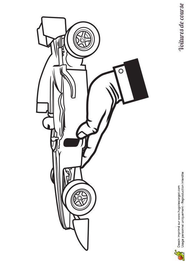 A colorier, un modèle réduit d'une Formule 1 dans la main d'une personne