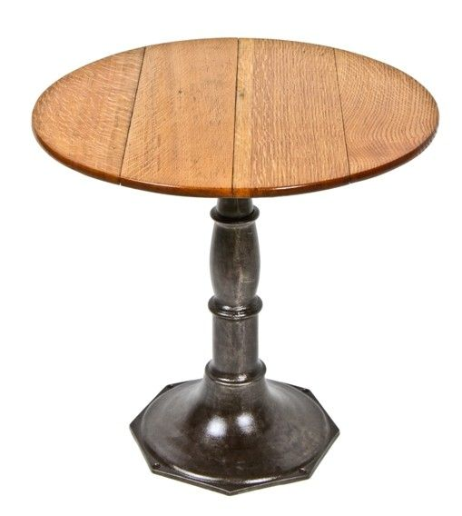 Urban Remains Chicago :: refinished 19th century saloon or pub table with finely turned cast iron base and quarted oak wood circular top