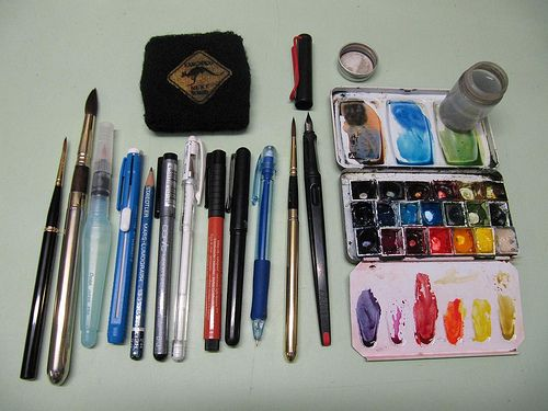 Liz Steel's sketching tools- Schminke tin w/WN and Daniel Smith wc paints, Lamy Joy pen w/ EF normal nib,  Noodlers Bulletproof Black ink, #6 Raphael sable travel brush, 0.5mm clutch pencil with red lead, Pentel pocket brush, Pitt Color pen 188 Superfine, White Gel pen, Permanent 0.3mm felt pen, 3H pencil,  Retractable eraser, Pentel waterbrush, #12 sable travel brush, #2 sable travel brush, small water container,  black wristband for wiping brush