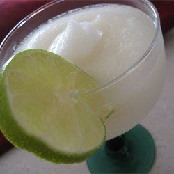 Frozen margaritas are made with limeade concentrate, tequila, triple sec, and ice.