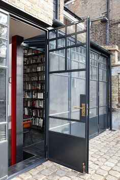 Gallery Of Trombe An External Shot Of Steel Doors Which Have Antique Bronze  Bauhaus Style Ironmongery A Modern Extension With Historic Elements With  Moderne ...