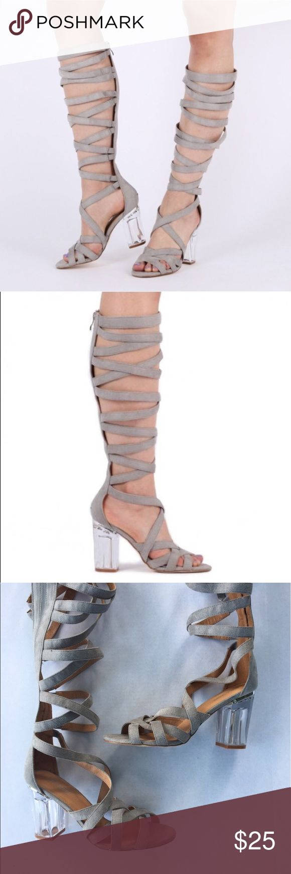 "Public Desire Carina Perspex Lace Up Heels. Public Desire Carina Perspex Lace Up Heels. Never worn perfect condition gladiator sandals with clear Perspex heels. The cross over thick strap design reaches all the way up to the knee so these are sure to make a dramatic entrance, elasticated at the end of the strap for comfort. A zip all the way up the back means these are easy to slip on. Heel Height: 3.6"". Calf Width: 10.4"". Shoe Height: 19"". Fabric Composition: Synthetic, Manmade Faux Suede…"