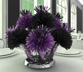 purple and black flowers---these appear to both be mums.