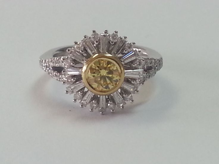 Exquisite fancy yellow diamond engagement ring with baguette petals.  Let your love bloom forever.   jackfriedman.co.za