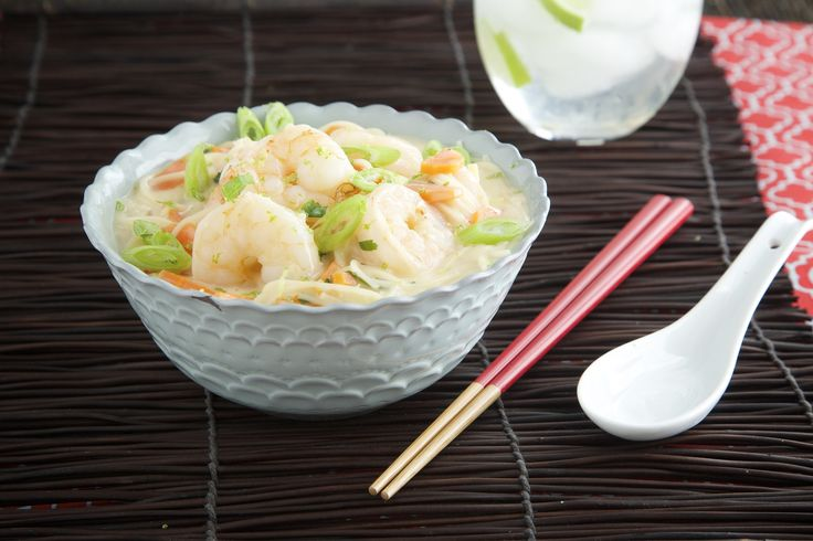 Sometimes you want a one-bowl meal that is deeply comforting but won't weigh you down. This Thai-inspired recipe delivers on both counts. The shrimp are gently poached in a coconut-lime broth and rema