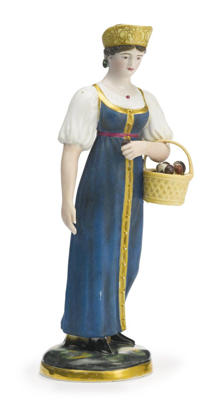 A Russian porcelain figure of a peasant woman with a basket of mushrooms, Gardner Porcelain Manufactory, Verbilki, 1820s-1830s, depicting a young peasant woman in blue sarafan and kokoshnik with a basket of mushrooms, the realistically painted circular base with gilt band, with blue underglaze factory mark, the number 2 incised in the paste, and 8 in black overglaze