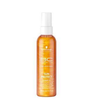 От воды - Спрей-блеск BC Sun Protect Что это: Водоотталкивающее масло с функцией УФ-защиты для волос, повергшихся солнечному воздействию.