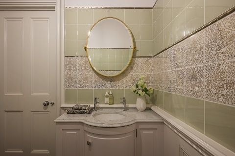 Green, White and Gold decorative tiles in bathroom