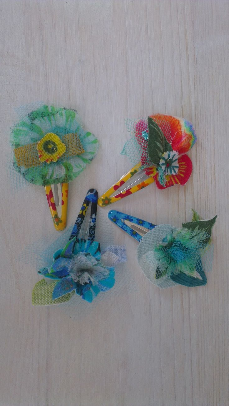 Sweet handmade clips in soft tissue, pastel colors. beatrice.cianfrui@facebook.com