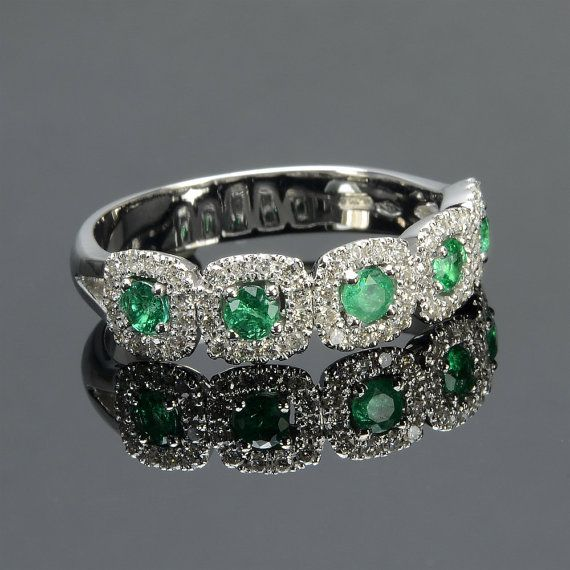 Ring in 18 kt gold with #emeralds of 0,35 ct and natural brilliant-cut white #diamonds of 0,30 ct. The #ring is available in white gold, rose gold, yellow gold but you can also customize carats, quality, and color of #gemstones.  All our #jewelry are made in italy. Contact us for any particular request.