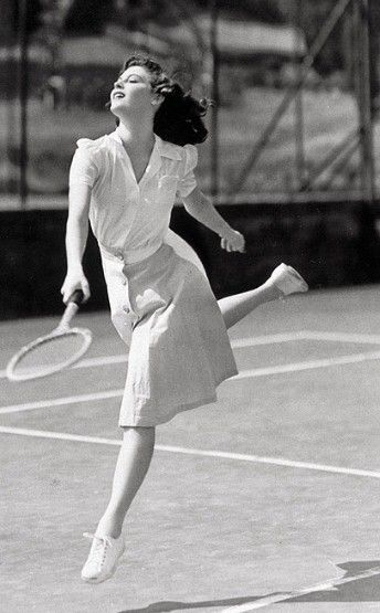 Ava Gardner looks graceful - if not that practical - in a blouse and midi-skirt in 1941.