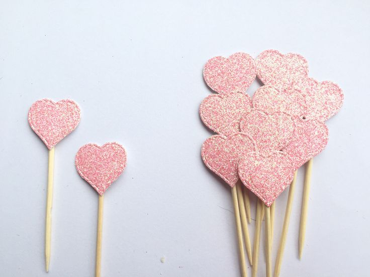 A personal favourite from my Etsy shop https://www.etsy.com/uk/listing/562557403/pink-heart-cupcake-toppers-baby-shower
