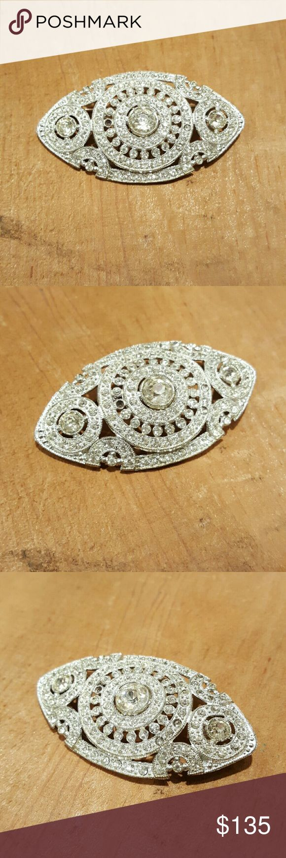 Rhinestone brooch Elegant and priceless!  All gems sparkly except for 1 missing see pics.  Hardly noticable especially when wearing. Vintage Jewelry Brooches