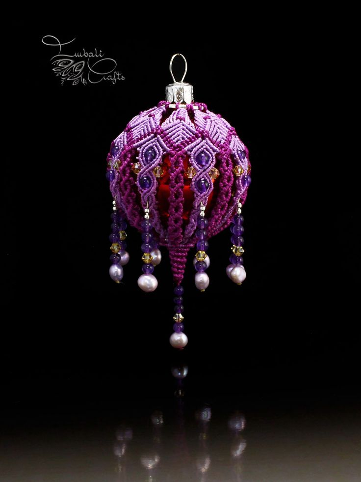 This is the original macrame Christmas bauble designed by Imbali Crafts. This is a unique handmade piece finished with genuine pearls and swarovski beads.