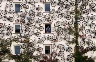 Bicycle Shop Signage: The owners of a bicylce shop, located in the German town of Altlandsberg, near Berlin, used the actual cycle merchandise as signage by mounting 120 bikes to an exterior wall of the shop.