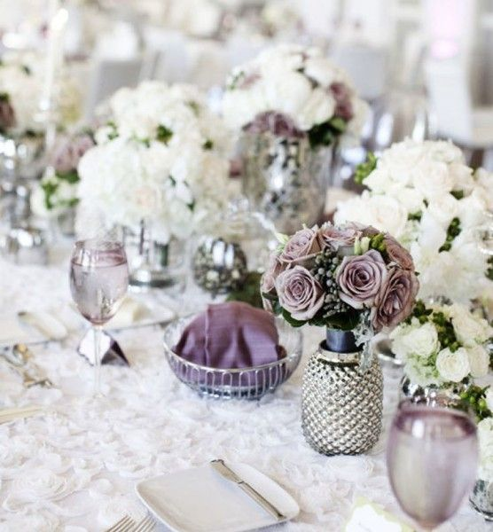 Lilac grey, silver and white table setting with mercury glass and textured floral tablecloths for an elegant and sophisticated look.