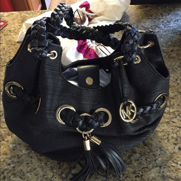 NWOT Michael Kors Black Purse Beautiful black Michael Kors bag features matching black leather tassels. Dust bag included. Listed on m e r c app as well Michael Kors Bags