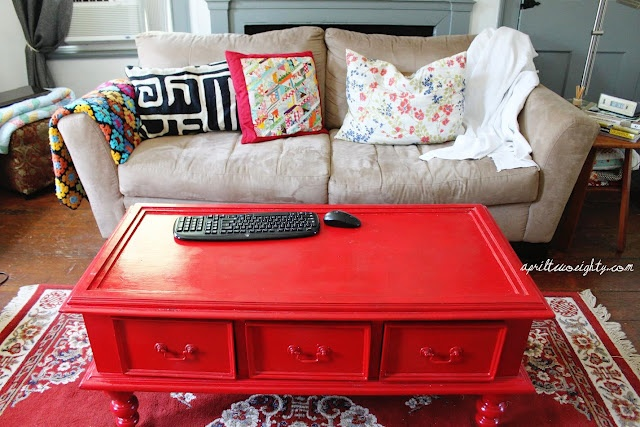 Love a red coffee table.