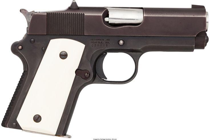 Detonics Combatmaster Semi-Automatic Pistol. Serial no. C20968, .45 caliber, 3 1/2-inch barrel with standard fixed sights. Black bonded finish. Left side of slide stamped: DETONICS .45. Bone grips. Checkered backstrap. Six shot magazine.