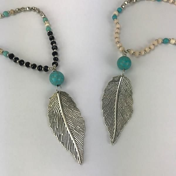 You will find this beautifully crafted long pendant necklace a delight.   The handmade design brings together a lovely leaf pendant suspended from a generous colour beaded strand of turquoise, silver and either black or papaya whip.