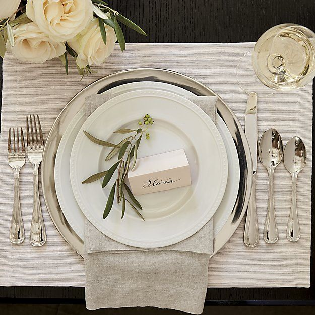 Add a pop of color, a dash of elegance or a hint of sophistication to your table with charger plates and buffet plates from Crate and Barrel. Order online.