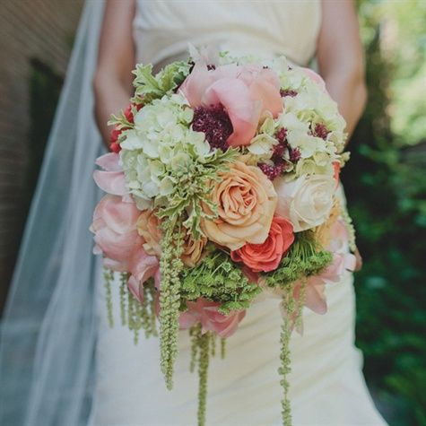 Kelsey carried a bouquet of coral peonys, vandella roses, green hydranda, parrot tulips, and fugi mums. from the album: A Coral Vintage Wedding in Rock Hill, SC