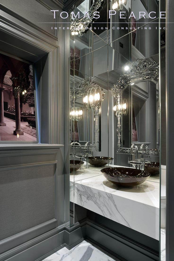 transitional powder room - I like the glossy grey molding work and the white/grey countertop and mirrors - I hate the sink