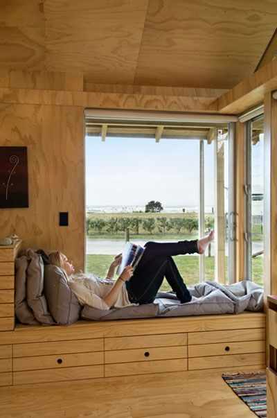 a storage/lounge nook... and if I wasn't so damn sick of looking at bare plywood all day long, this would appeal even more
