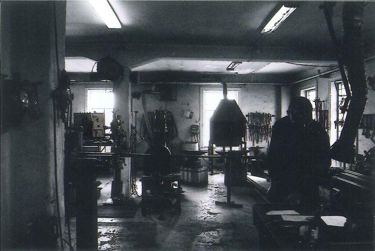 Smithy and blacksmith in back light. Arlöv, Sweden.
