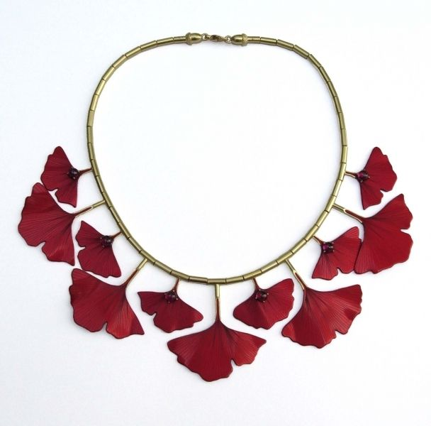 Necklace | Roger Doyle.  18ct yellow gold with cabochon rhodelite garnets and red anodised aluminium